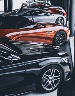 five assorted color cars parked inside room